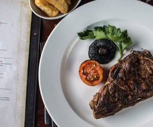 steak, portobello mushroom, and roast tomato image