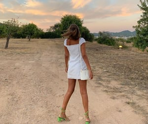 White Summer Dress, short brown hair, and lace up heels image