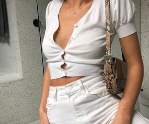 gold jewelry, white outfit, and short sleeve top image