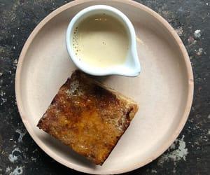 cinnamon bun, tea, and custard image