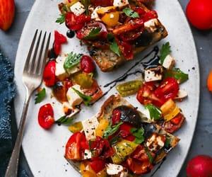tomato, garlic bread, and mozzarella cheese image