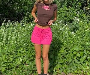 gold jewelry, graphic tee shirt, and pink mini skirt image
