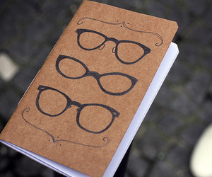 book, glasses, and notebook image