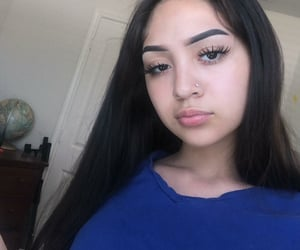 eyebrows, nose ring, and shirt image