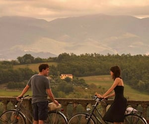 couple, normal people, and bicycle image