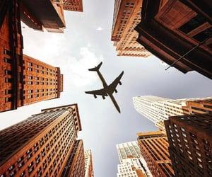 city, airplane, and sky image