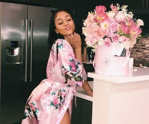 saweetie and flowers image