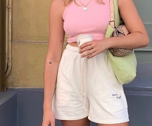 heart necklace, white shorts, and pink crop top image