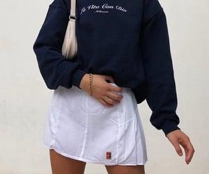 dark blue sweater, white mini skirt, and fashionista fashionable image