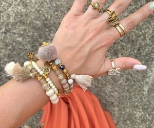 arm candy, bracelet, and rings image