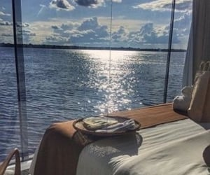 sky, ocean, and sun image