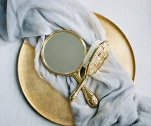 brush, gold, and hand mirror image