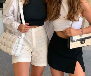 black mini skirt, black crop top, and white crop top image