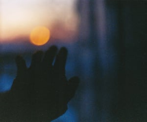 hand and sunset image
