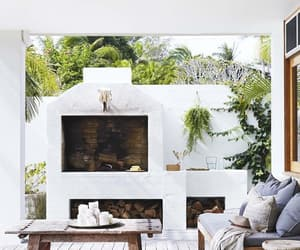 backyard, fireplace, and outdoor furniture image