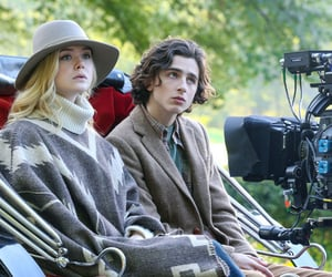 Elle Fanning, timothee chalamet, and a rainy day in new york image