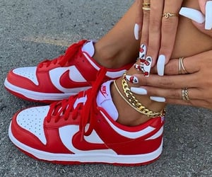 gold jewelry, nails, and red sneakers image