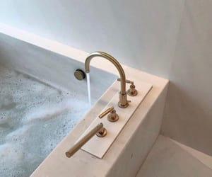 bath tub, bathing, and bathroom image