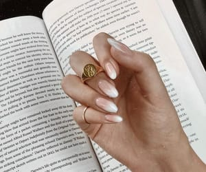 nails, book, and jewelry image