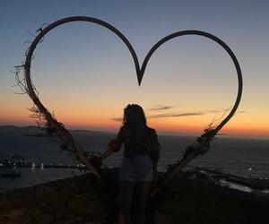 mykonos and sunset image