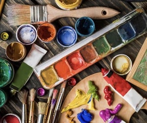 Brushes, colors, and paint image