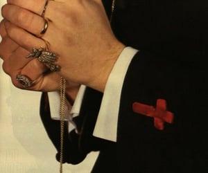 ?, crucifix, and dark image