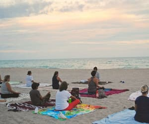 sunset, practice, and yoga on the beach image