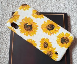 book, print, and sunflower image