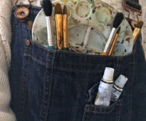 Brushes, watercolours, and jeans image