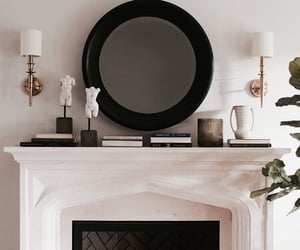fireplace, interior, and mirror image