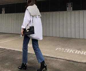 grey sweater, white blouse, and black ankle boots image