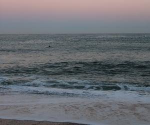 ocean, sunrise, and surfers image
