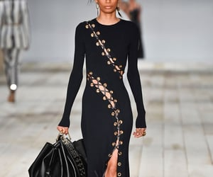 Alexander McQueen, black dress, and fashion show image
