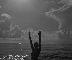 black and white, sun, and sea image