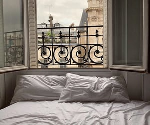 view, bed, and city image
