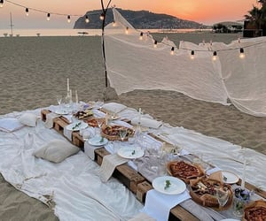 beach, picnic, and dinner setting image