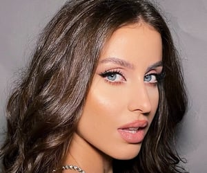 blue eyes, brunette, and curly hair image