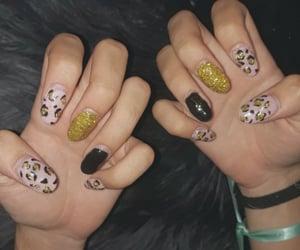 acrylics, gold glitter, and nail art image
