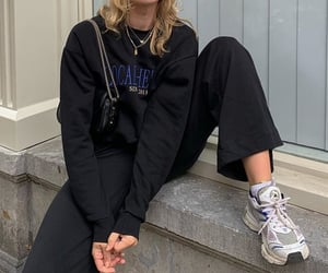 black sweater, everyday look, and graphic sweater image