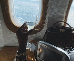 fendi, rolex, and first class image