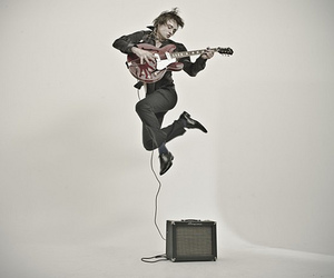 guitar, singer, and jump image