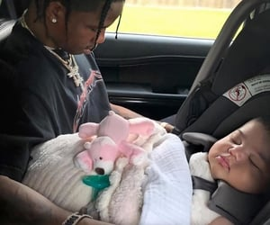 father, travis scott, and stormi webster image