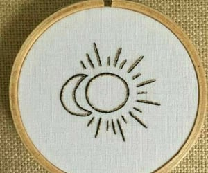 circle, sun, and embroidery image