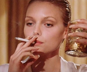 cigarette, scarface, and michelle pfeiffer image