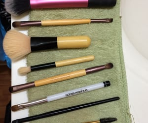 Brushes, makeup, and set image