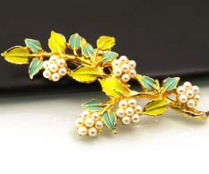 costume jewelry, flower brooch, and green and yellow image