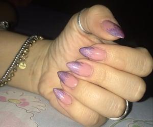 nails, a mandorla, and rosa image