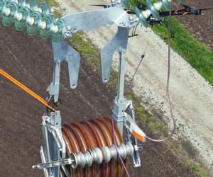 electricity, powerline, and structure image