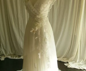 The ANDREESIA Dress-Made up of lace, tulle and some incredible handmade florals. Laces are an optical white–almost silver when the light hits it. Available via Amy Jo Tatum Bridal Couture