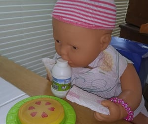 dolls, pretend food, and pretend play image